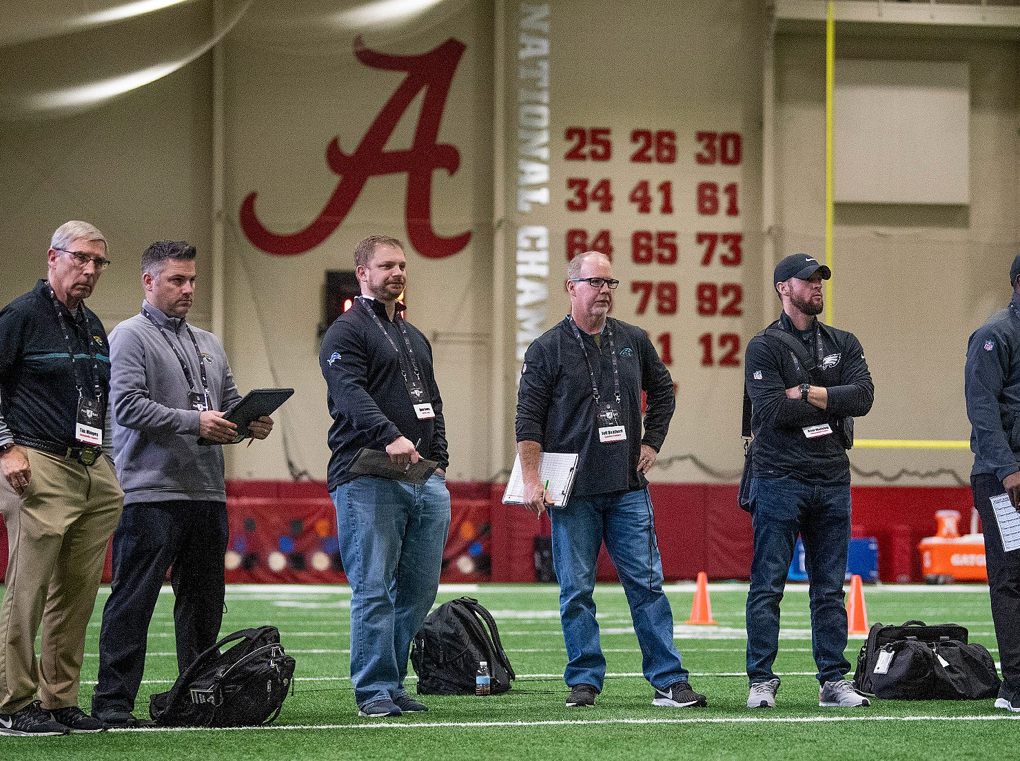 NFL scouts watch during Pro Day on the University of Alabama campus in Tuscaloosa, Ala., on Tuesday March 19, 2019.
