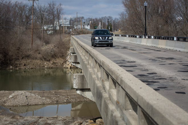 Cars pass over the Tiger Drive bridge in Yorktown March 19 using both a northbound and southbound lane. Starting April 1 the bridge will move to single lane travel that will use a signal to direct traffic as construction work on the bridge begins again.