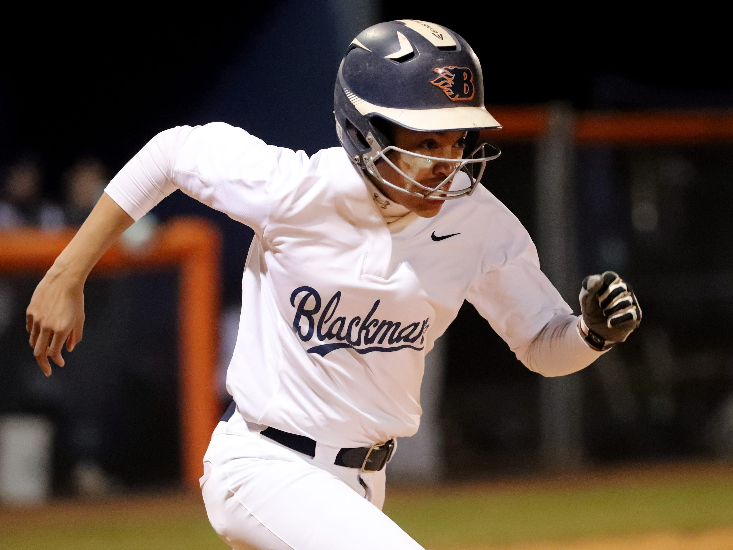 Blackman's Kalei Harding (8) runs to first base during the game against Siegel, on Monday, March 18, 2019, at Blackman.
