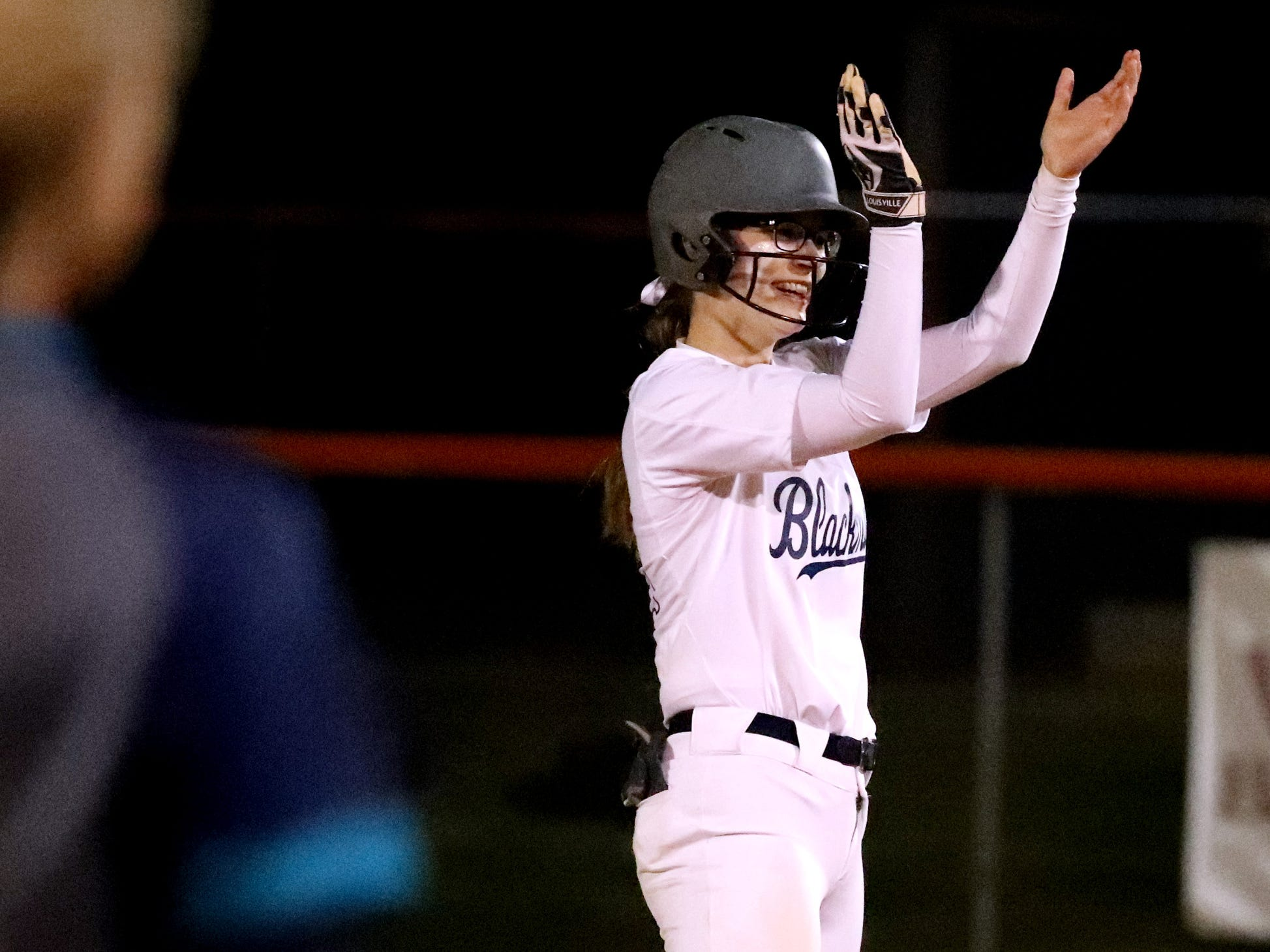Blackman's Alissa Hart (22) celebrates making it to second base on an error by Siegel, on Monday, March 18, 2019, at Blackman.