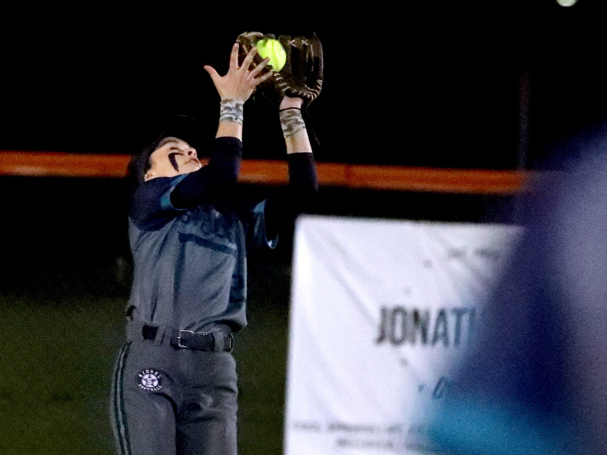 Siegel's Reagan Duran (2) makes a catch and an out against Blackman, on Monday, March 18, 2019, at Blackman.
