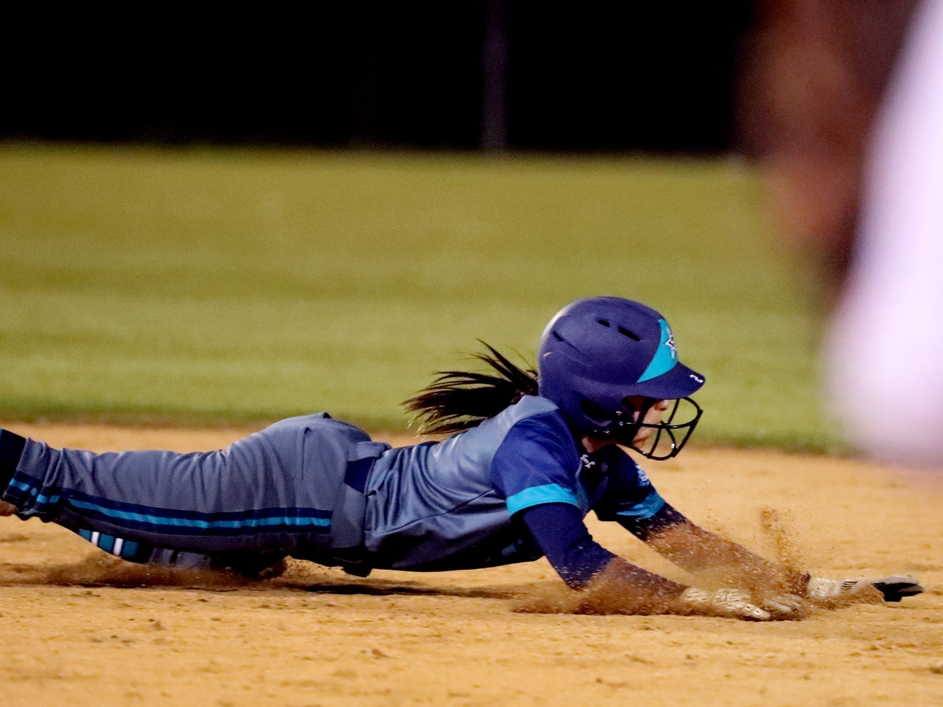 Siegel's Reagan Duran (2) dives back to second base during the game against Blackman, on Monday, March 18, 2019, at Blackman.