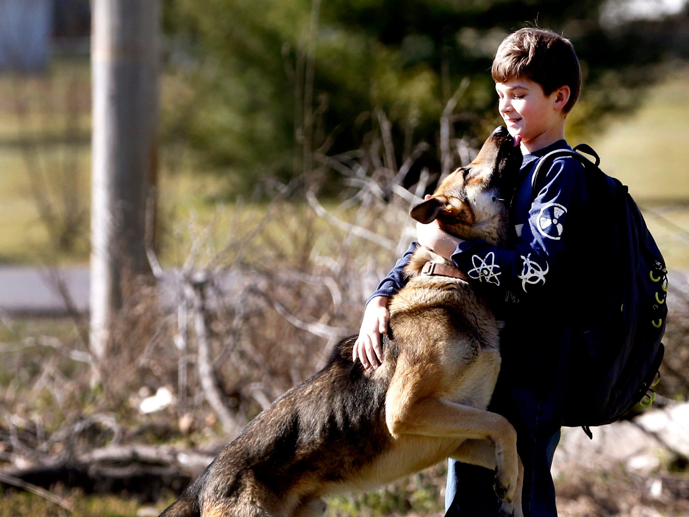 Justin White, 10, is surprised as he is greeted by his dog Goblin on Tuesday, March 19, 2019, after Goblin had been officially reported missing from the family's Christiana home since March 10.