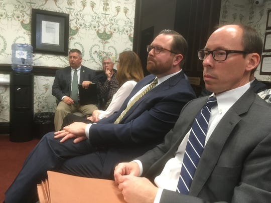 Outgoing Rutherford County Attorney Josh McCreary, right, sits next to his firm partner and recommended successor Nick Christiansen during a Monday County Commission Steering, Legislative & Governmental Committee meeting at the County County Courthouse.