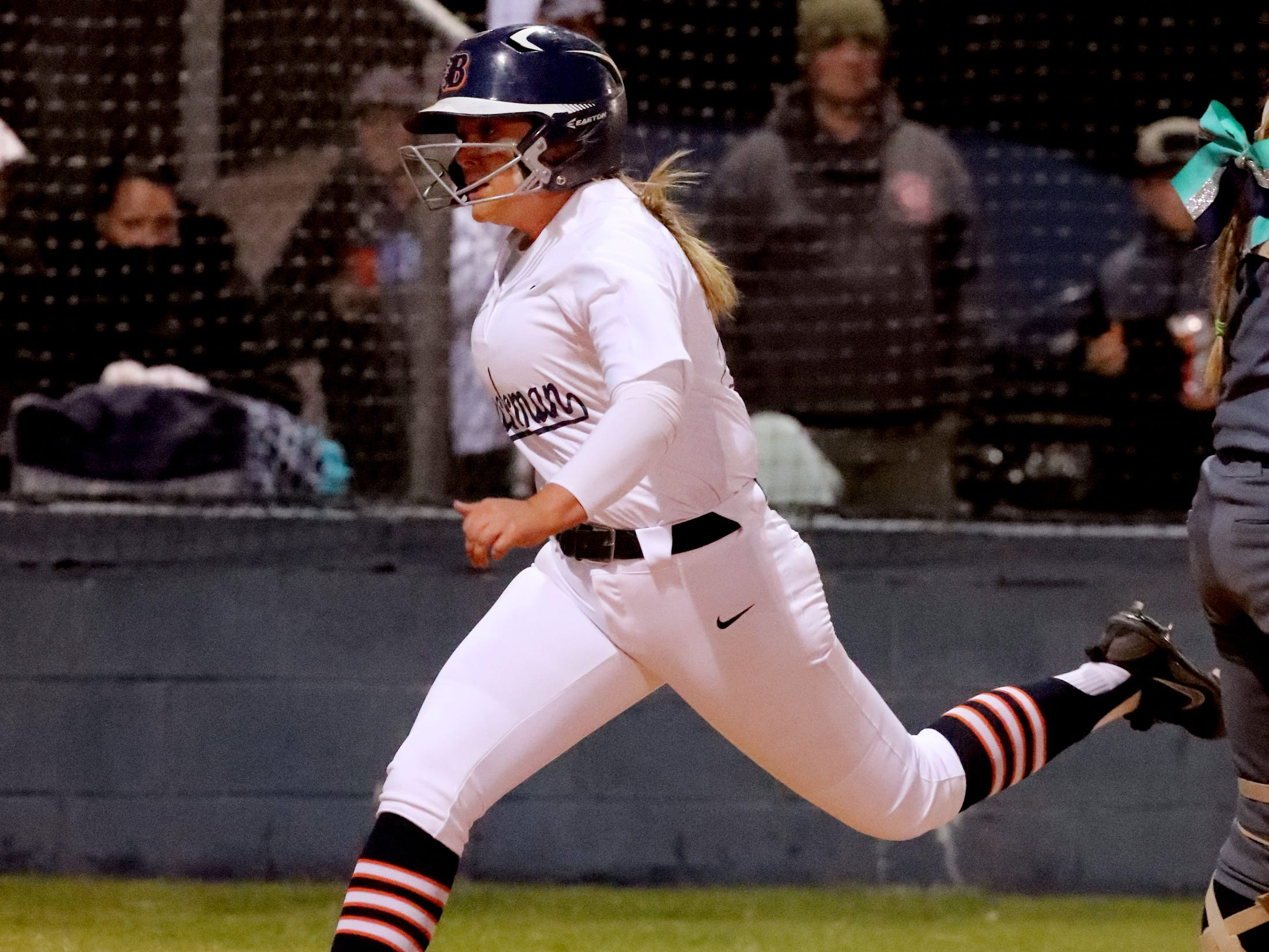 Blackman's Ashlynn Hamby (25) crosses home plate during the game against Siegel, on Monday, March 18, 2019, at Blackman.