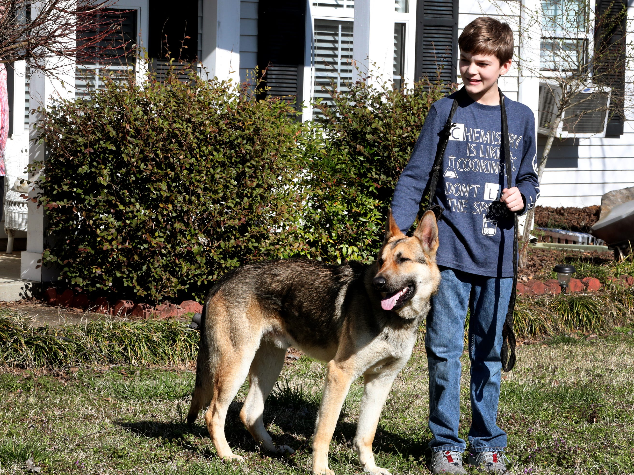 Justin White, 10, was reunited with his dog Goblin on Tuesday, March 19, 2019, after the dog was returned.