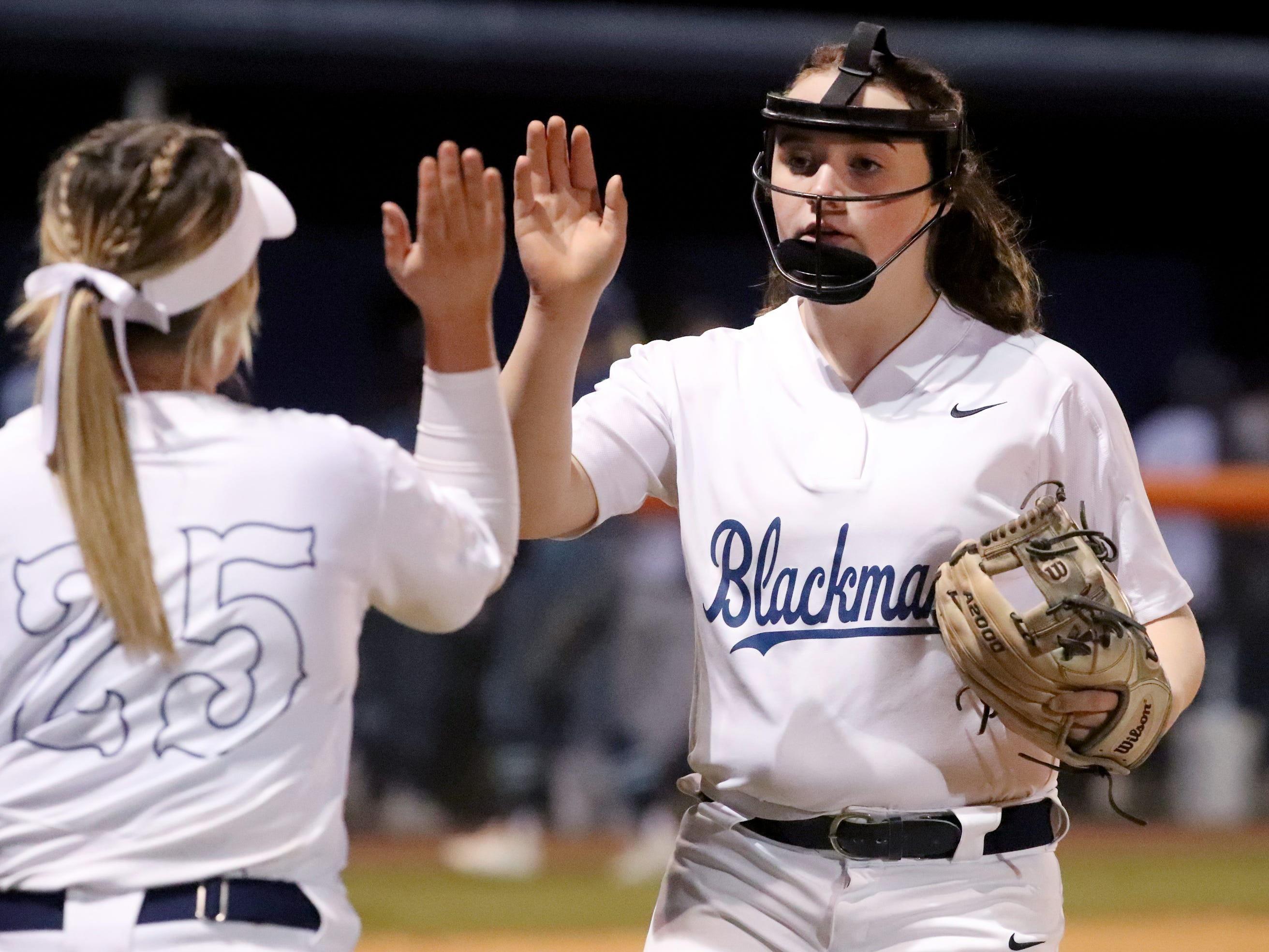 Blackman's Ashlynn Hamby (25) and Blackman's Killian Roberts (24) give each other a high-five after Blackman's Roberts  made an out to end the inning against Siegel, on Monday, March 18, 2019, at Blackman.
