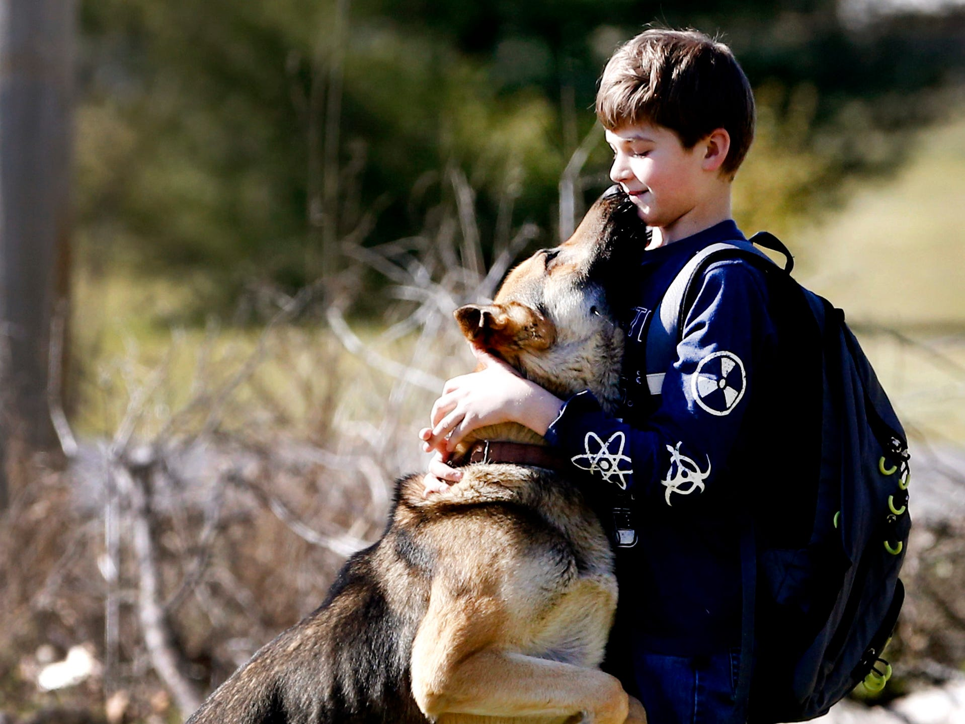 Justin White, 10, is surprised as he is greeted by his dog Goblin, on Tuesday, March 19, 2019, after Goblin had been missing from the family's Christiana home for nine days.