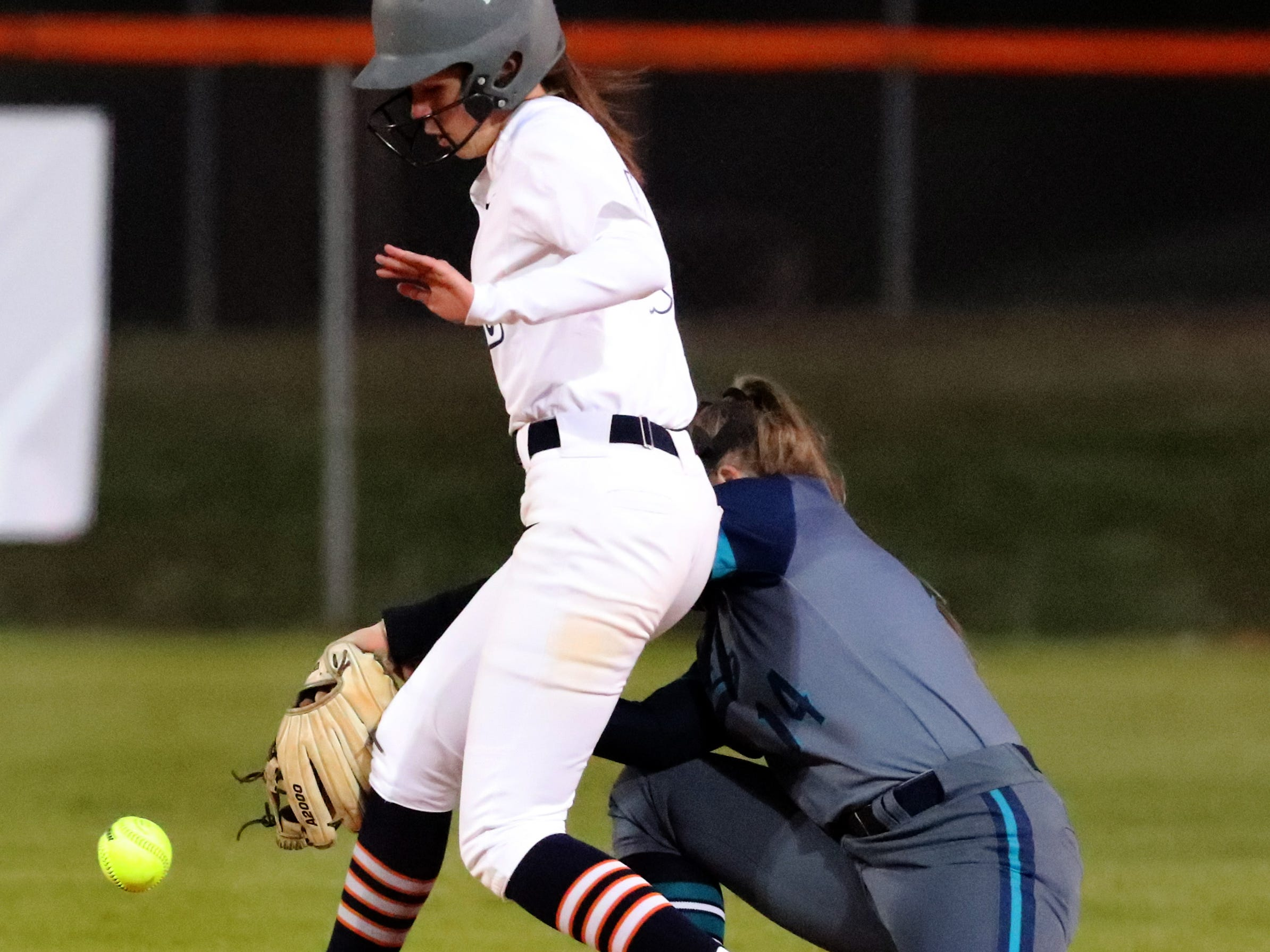 Blackman's Jada Chase (7) runs to second base as Siegel's Claire Czajkowski (14) tries to get her out, on Monday, March 18, 2019, at Blackman.