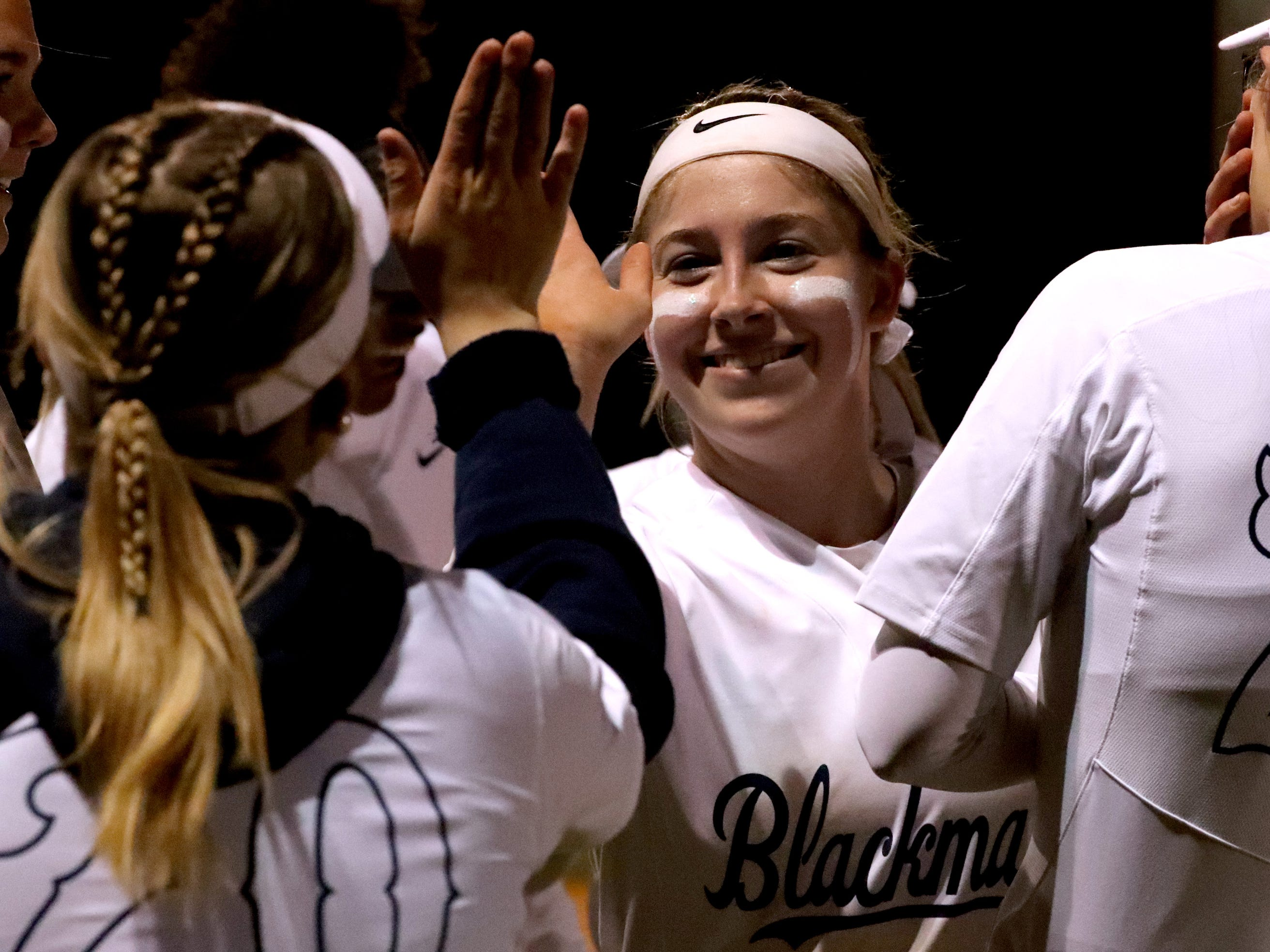 Blackman's Ashlynn Hamby (25) and Blackman's Kaylyn Tarpley (20) give each other a high-five before an inning during the game against Siegel, on Monday, March 18, 2019, at Blackman.