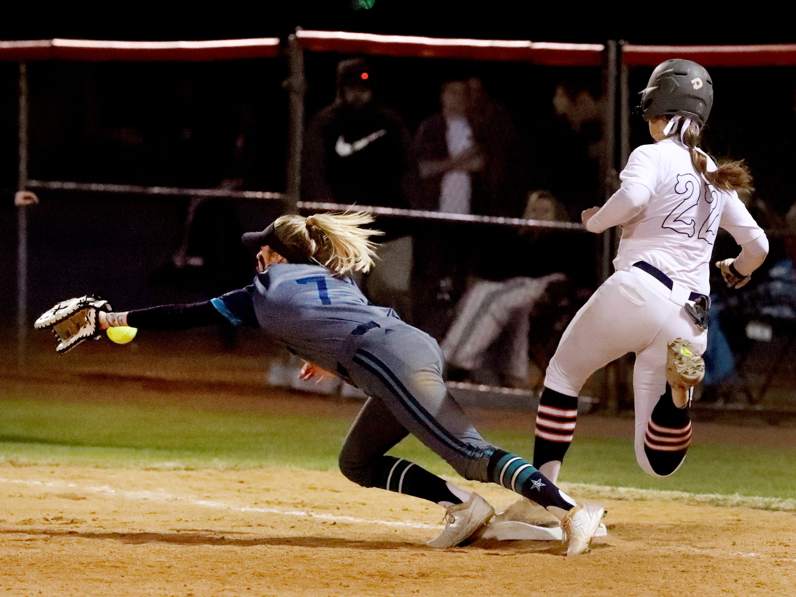 Siegel's Presley Leebrick (7) dives for a ball as Blackman's Alissa Hart (22) runs to first base, on Monday, March 18, 2019, at Blackman.
