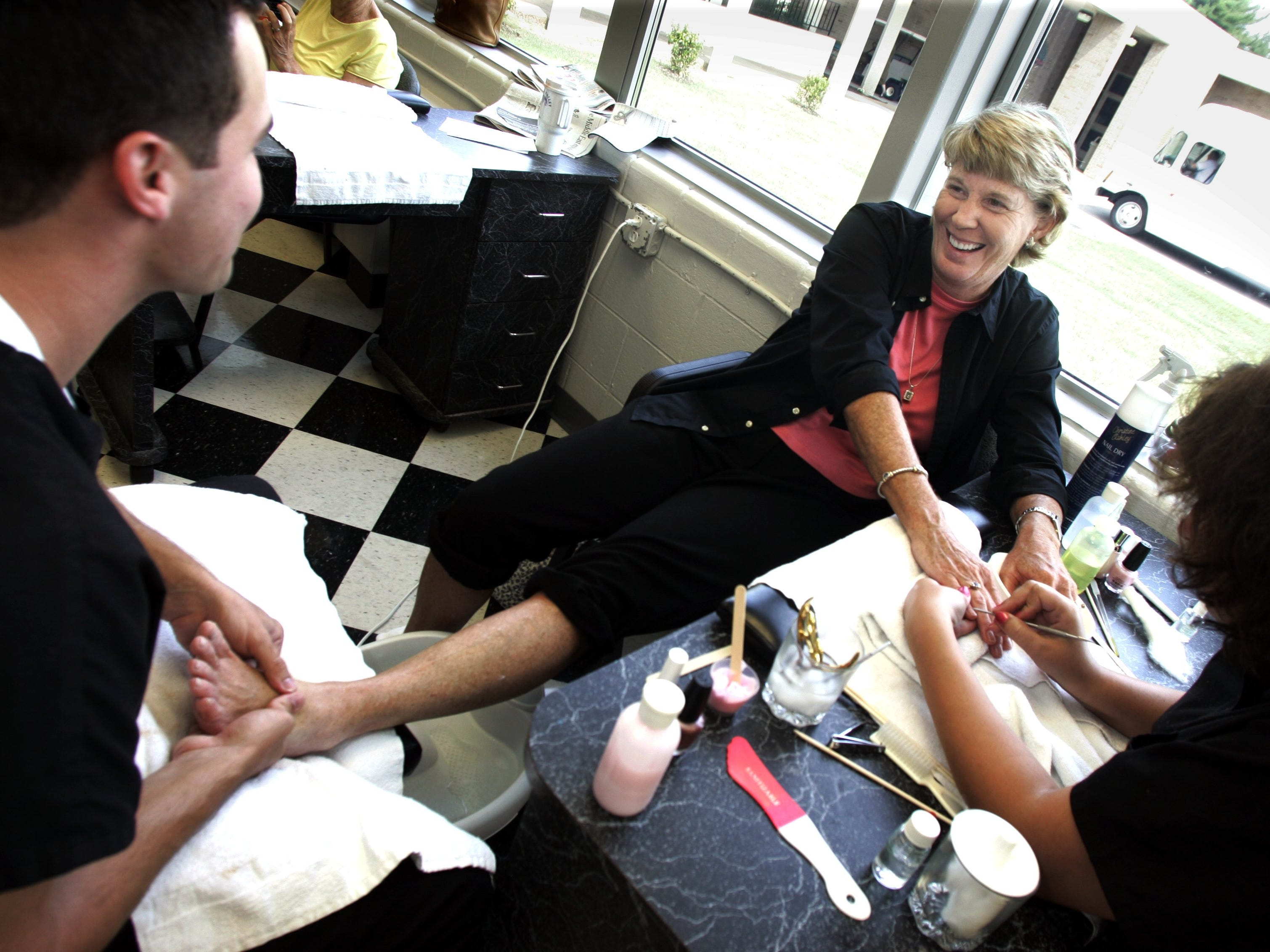Lady of luxury Mary Hance, aka Ms. Cheap, gets the royal treatment as she has a manicure and pedicure at Tennessee Technology Center on White Bridge Road on July 18, 2006. Troy Dailey handles the feet while Jordon Fish takes care of the hands.