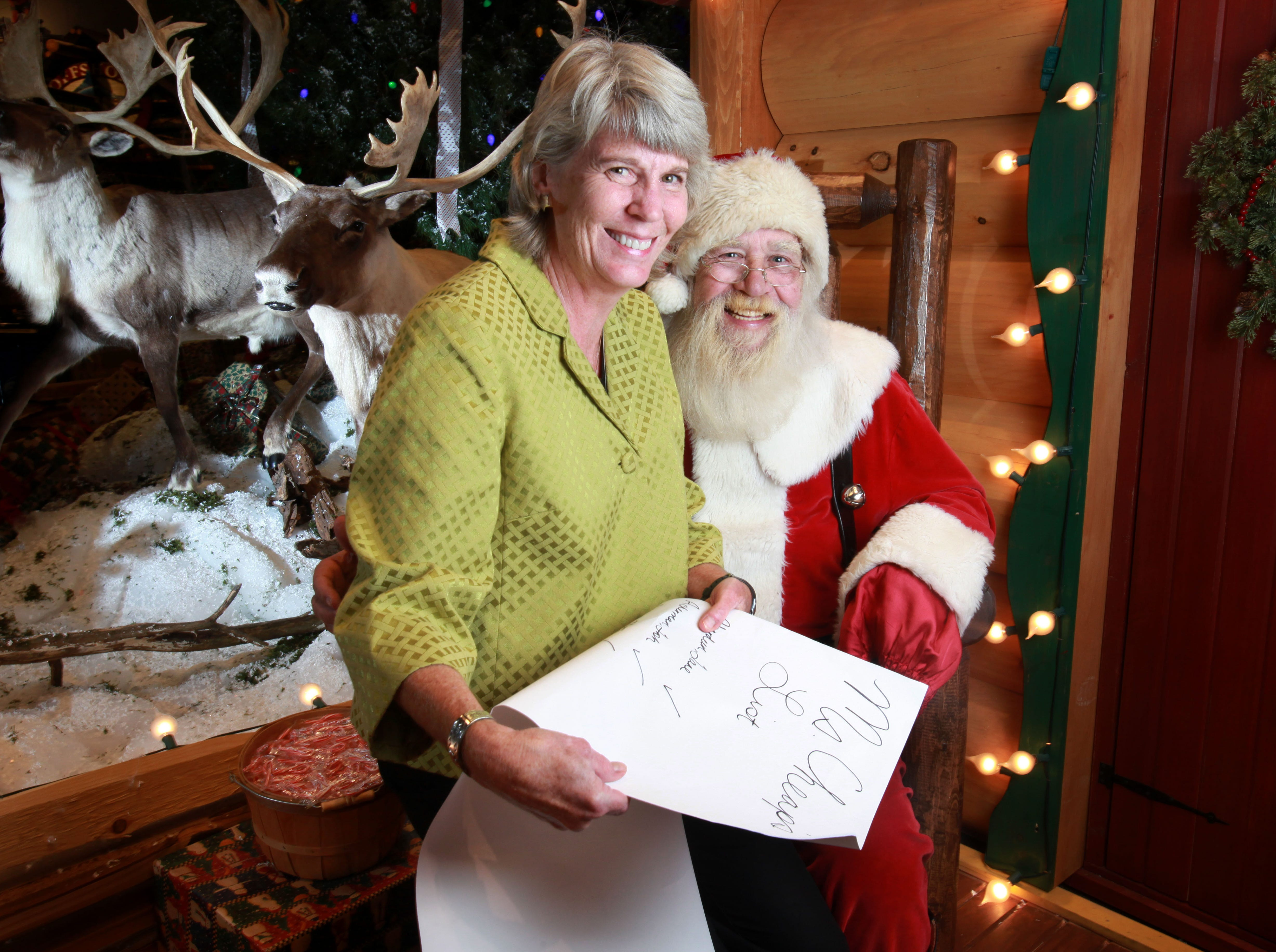 Mary Hance sits on Santa's lap at Santa's Wonderland of the Bass Pro Shop in Opry Mills on Nov. 23,  2009.