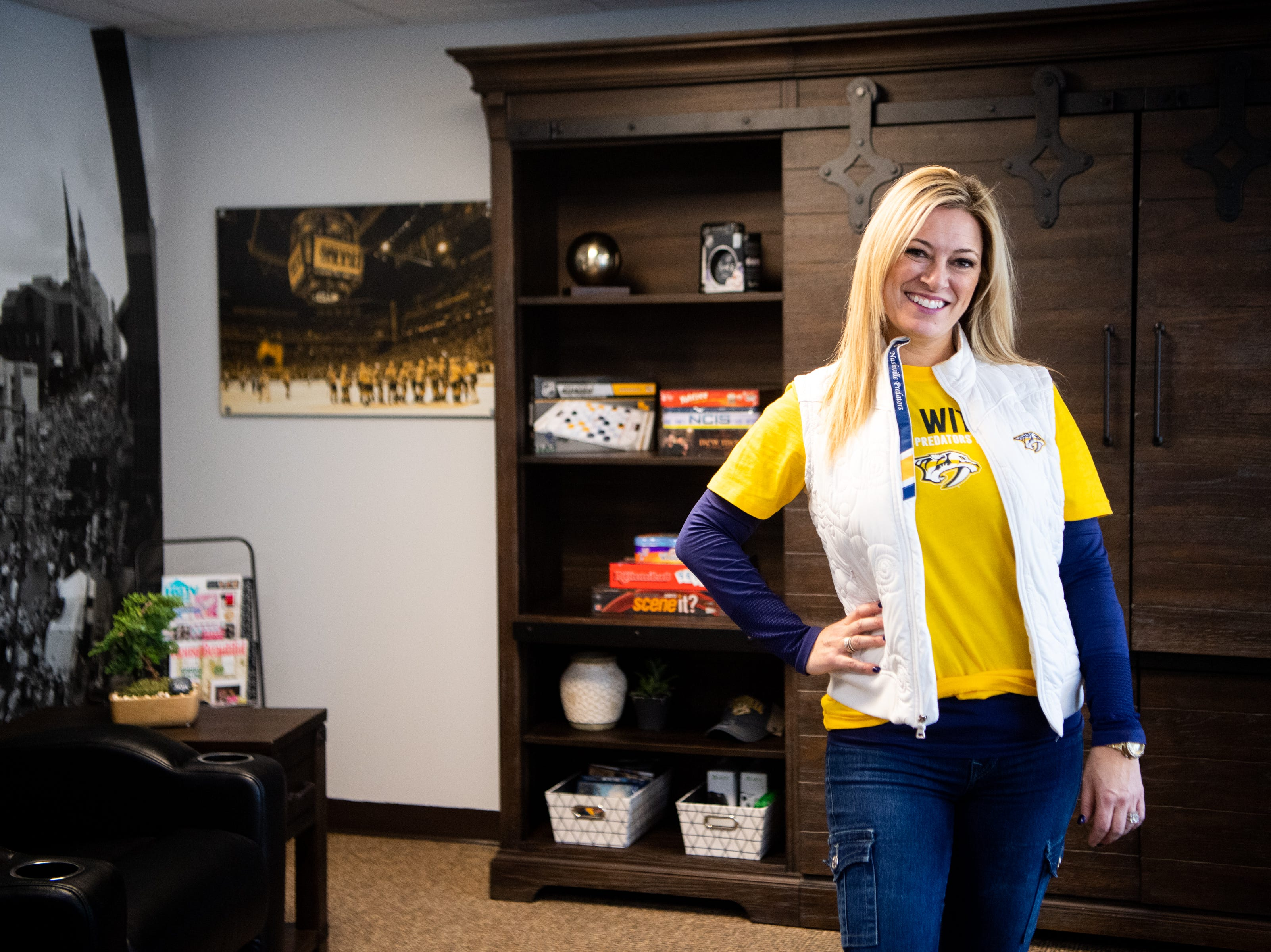 Kristen Laviolette poses for a portrait after helping makeover the entertainment room at Memorial Foundation Hope Lodge as a project for the wives, girlfriends and fiancees of the Nashville Predators Tuesday, March 12, 2019, in Nashville, Tenn.