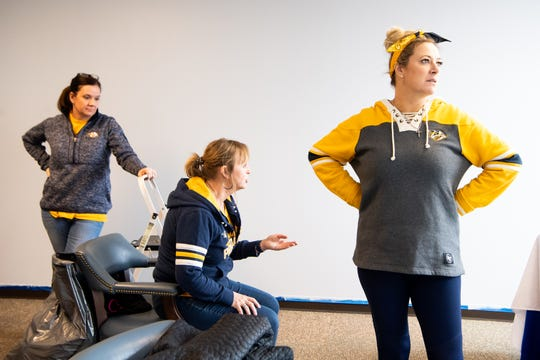 Tracey Henry, Rhonda McCarthy and Kristen Laviolette plan while making over the entertainment room at Hope Lodge on March 12, 2019.