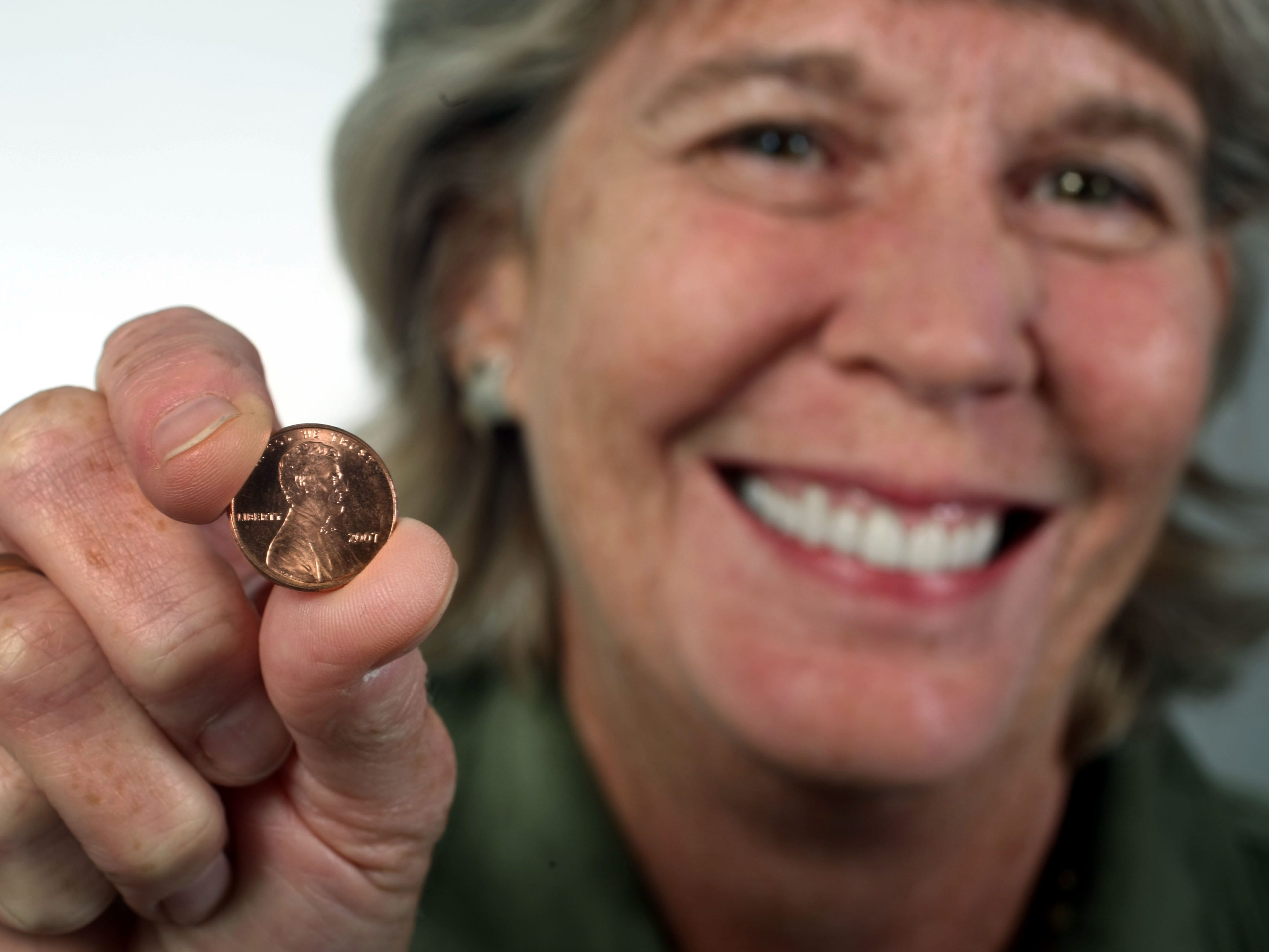 Mary Hance, aka Ms. Cheap, poses with a penny in the studio Sept. 30, 2009. She was promoting her Penny Drive, during which she asks readers for their pennies for Second Harvest Food Bank.