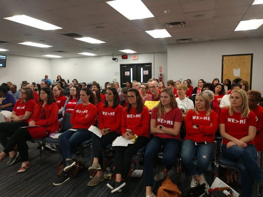 Nashville schools teachers dressed in red advocate for salary step raises at a Metro Nashville Public Schools board budget on Tuesday, March 19, 2019 in Nashville, Tennessee.
