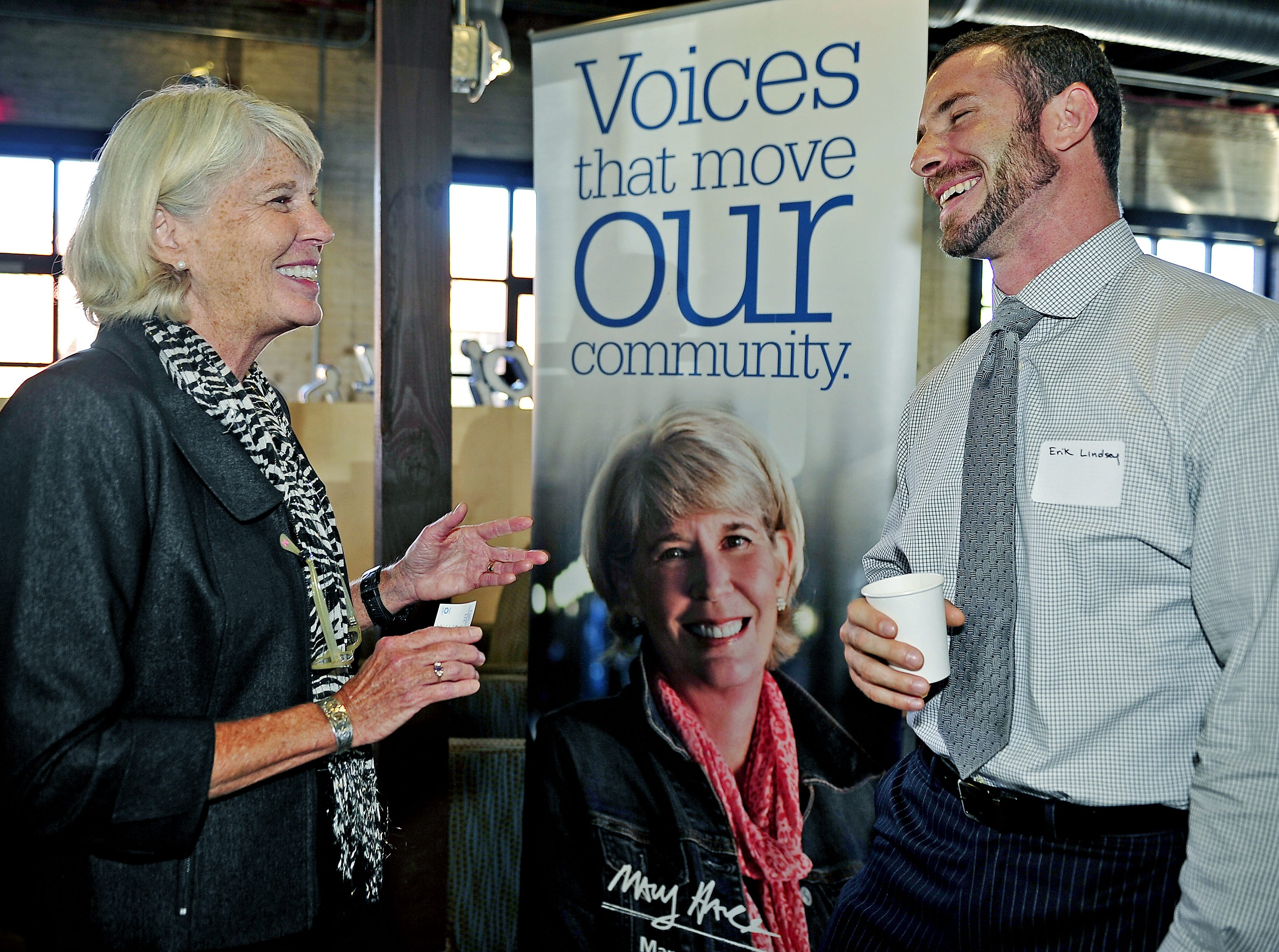 Mary Hance, better known as Ms. Cheap of The Tennessean, left, talks with Erik Lindsey during the Meet The Tennessean event at Emma's Bistro in Nashville on Oct. 13, 2015.