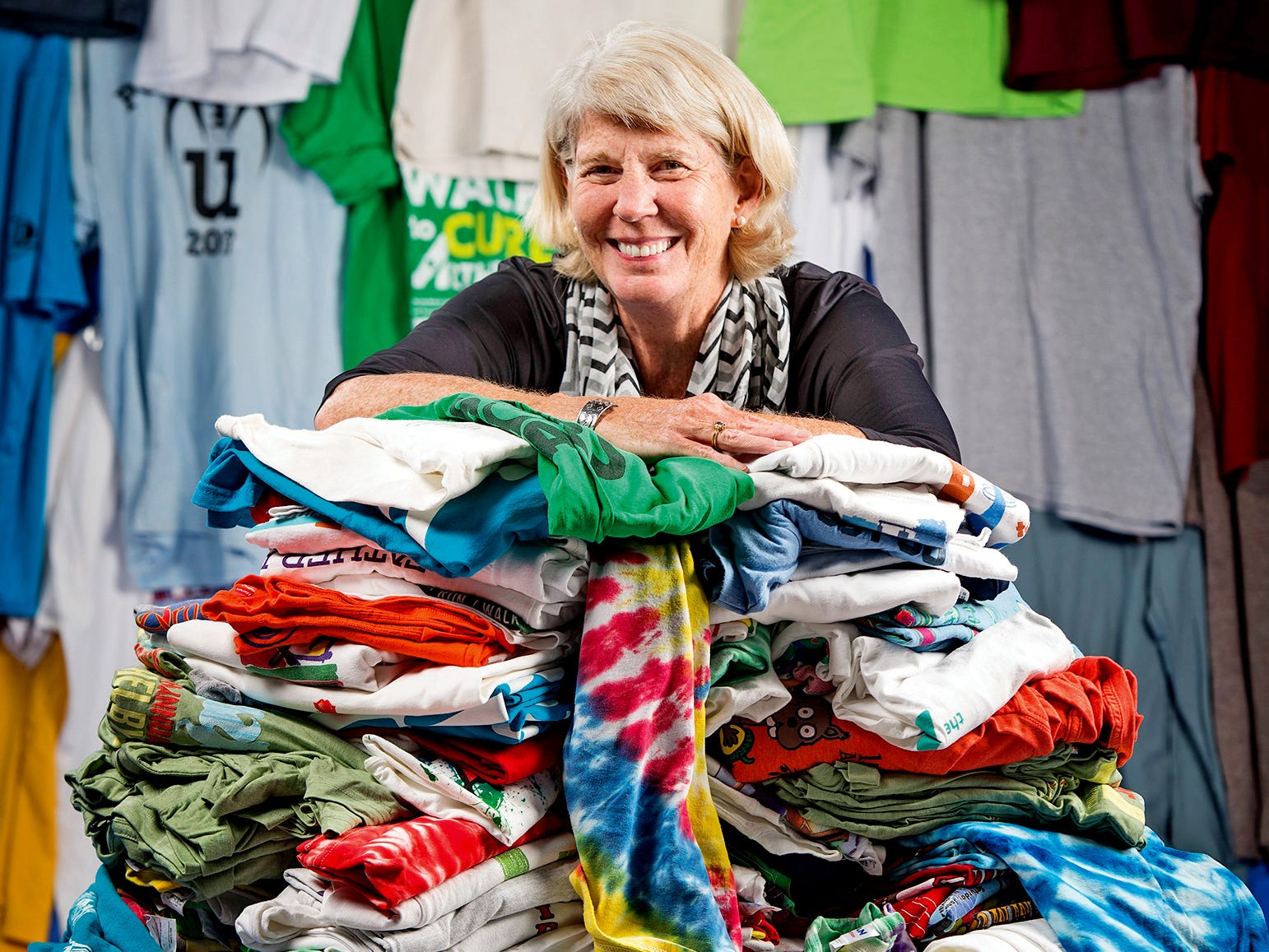 Mary Hance's Ms. Cheap, who posed with donated T-shirts at The Tennessean's office June 21, 2016, is all smiles after so many T-shirts were donated in her drive for Room in the Inn.