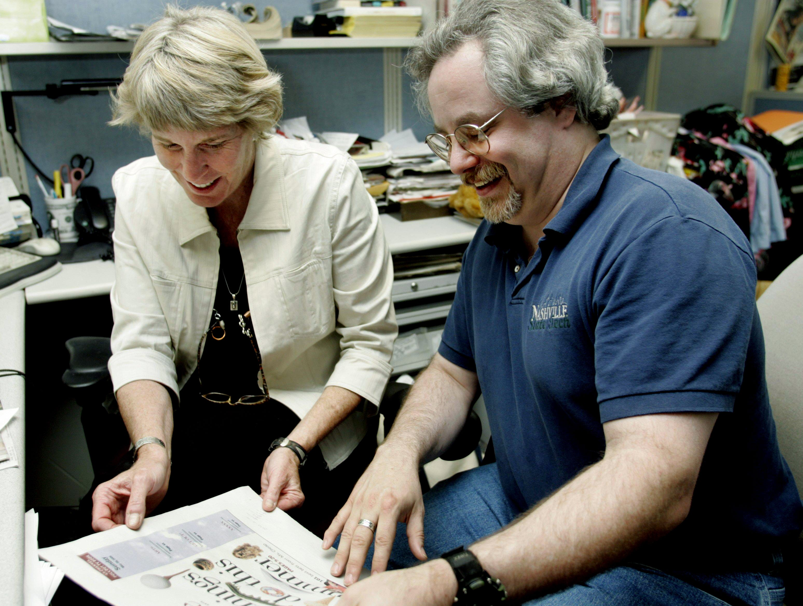 Ms. Cheap's Mary Hance works with her new apprentice Robert Overall III at The Tennessean's office May 25, 2006.