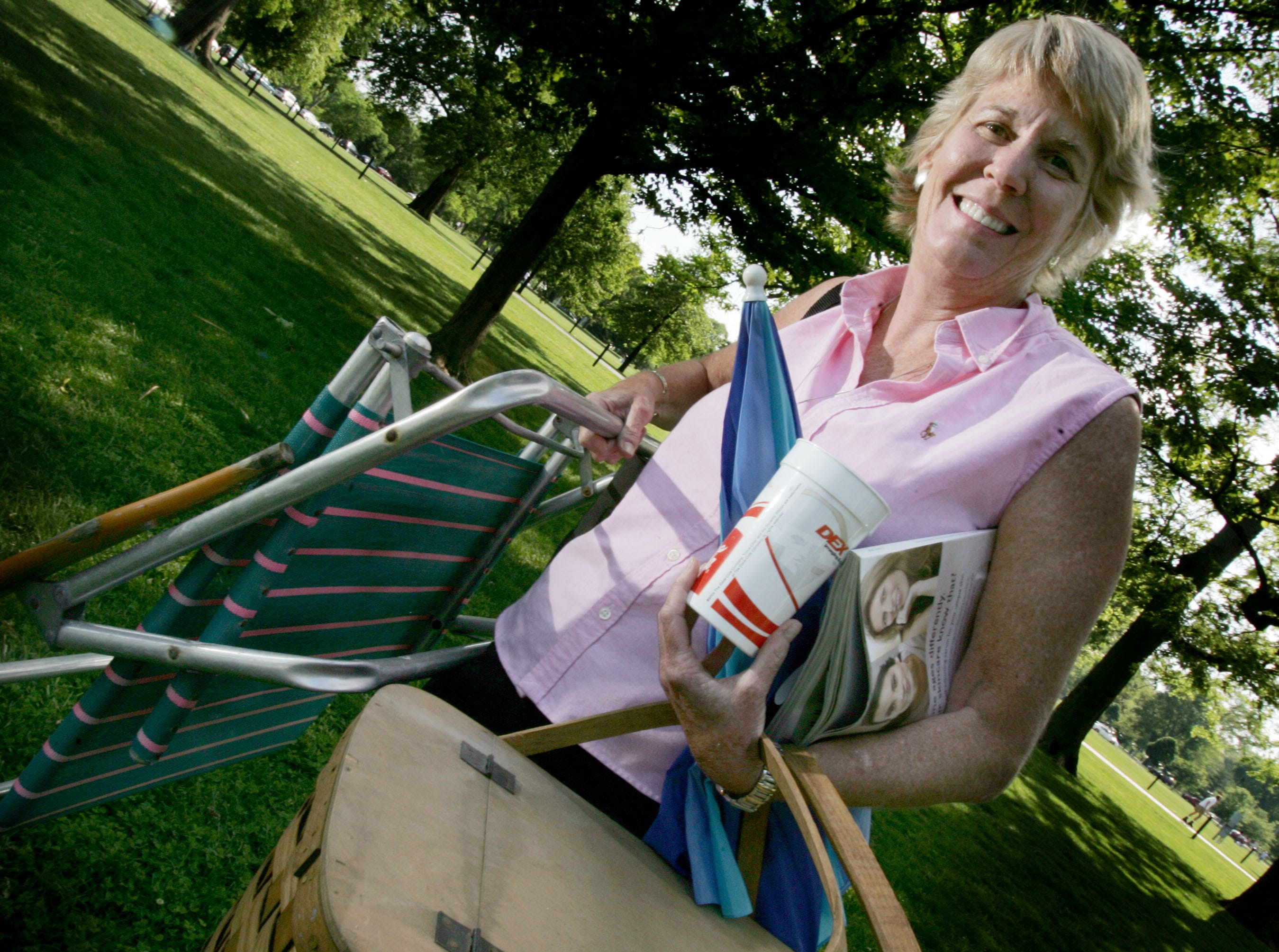 Mary Hance holds all her summer fun supplies in Centennial Park on May 16, 2007.