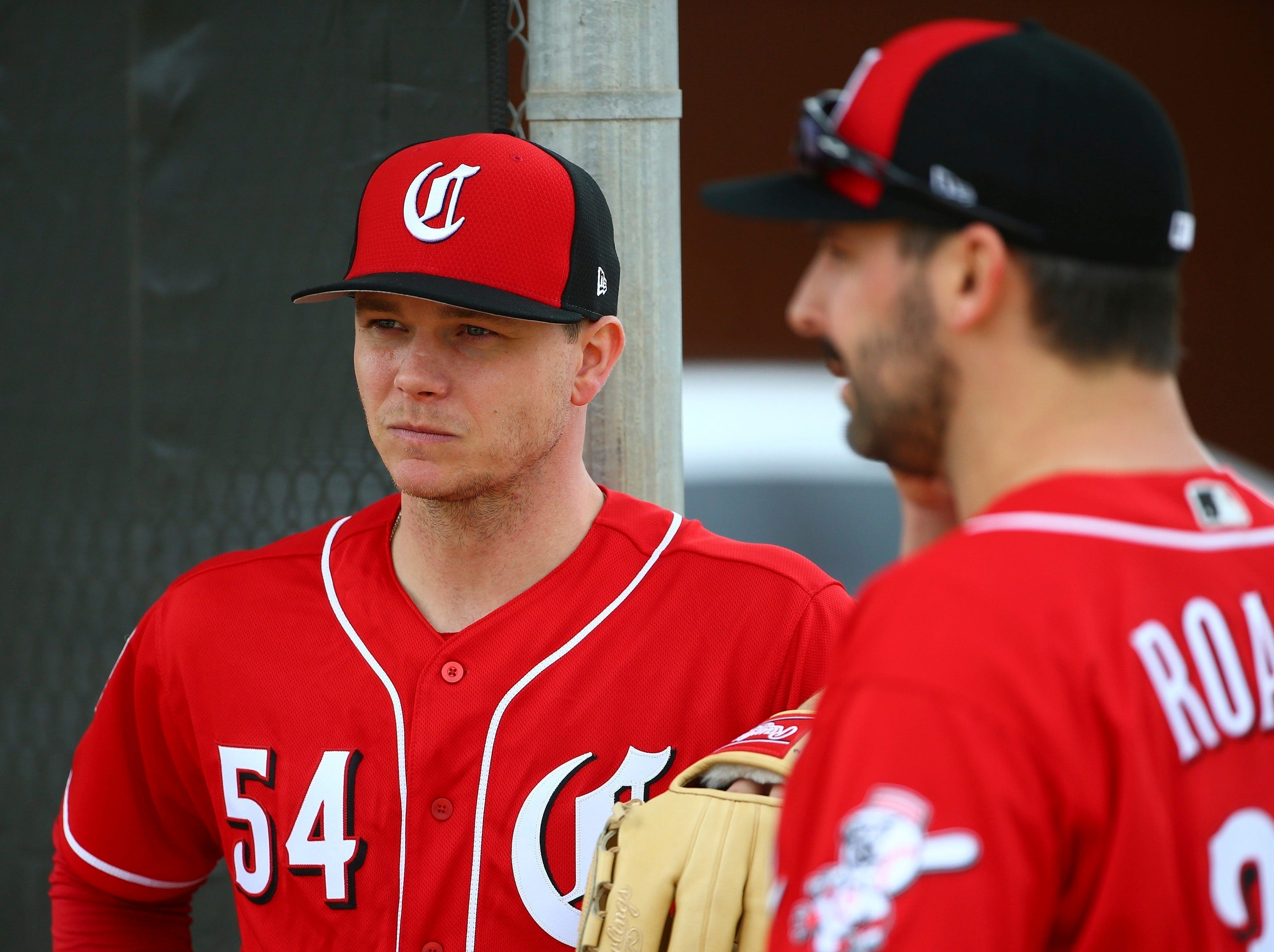 Cincinnati Reds pitcher Sonny Gray (54) and Tanner Roark pause during workouts at the Cincinnati Reds spring training baseball facility in Goodyear, Ariz., on Feb. 13, 2019.
