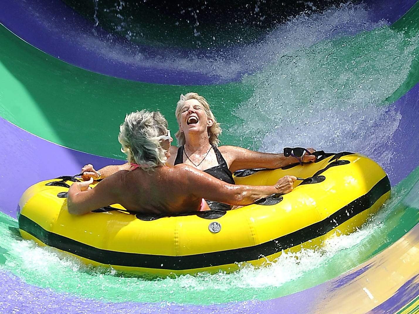 """Mary Hance, aka Ms. Cheap, laughs with excitement as she and Jennifer Clemens come out of the latest addition at Nashville Shores, """"The Big Kahuna,"""" on June 18, 2015. Clemens showed Ms. Cheap how she makes the most of her Nashville Shores season pass."""