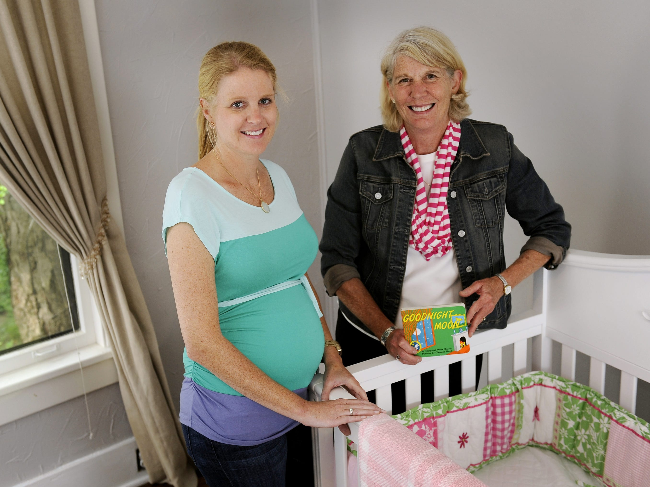 Elizabeth Miller, left, and her mother, Mary Hance, aka Ms. Cheap, are excited May 6, 2013, about the arrival of their daughter and granddaughter, respectively, this summer.