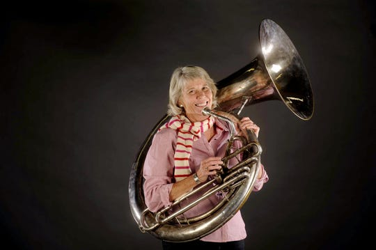 Ms. Cheap, aka Mary Hance, has been a Tuba Christmas fan for years. Now her Ms. Cheap Penny Drive for Second Harvest is part of the event.