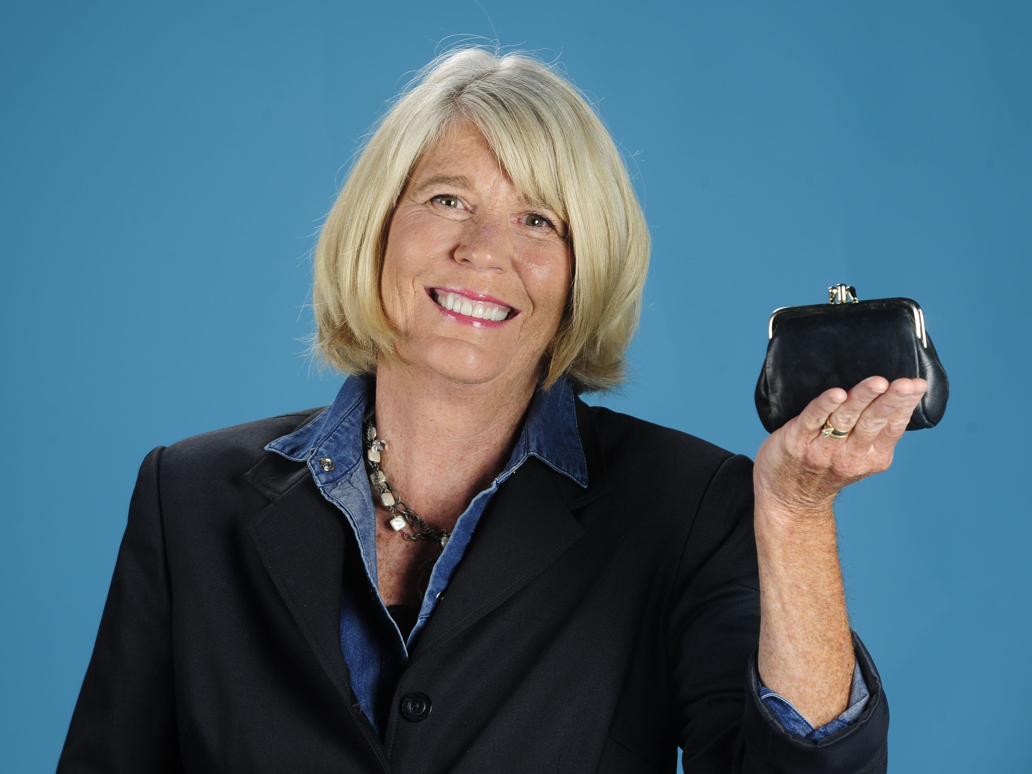 Mary Hance, aka Ms. Cheap, poses for a new column photo in the studio Oct. 12, 2013.
