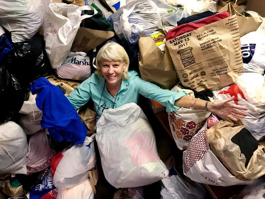 Mary Hance, aka Ms. Cheap, is happily buried in T-shirts that were donated in previous Ms. Cheap's T-shirt drive for Room in the Inn. The fourth annual T-shirt donation drive runs through  June 27.