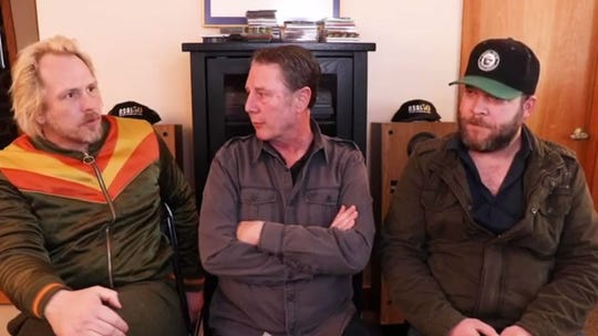 Luke Dick, left, and Jeff Hyde, right, talk to Bart Herbison, center, about songwriting