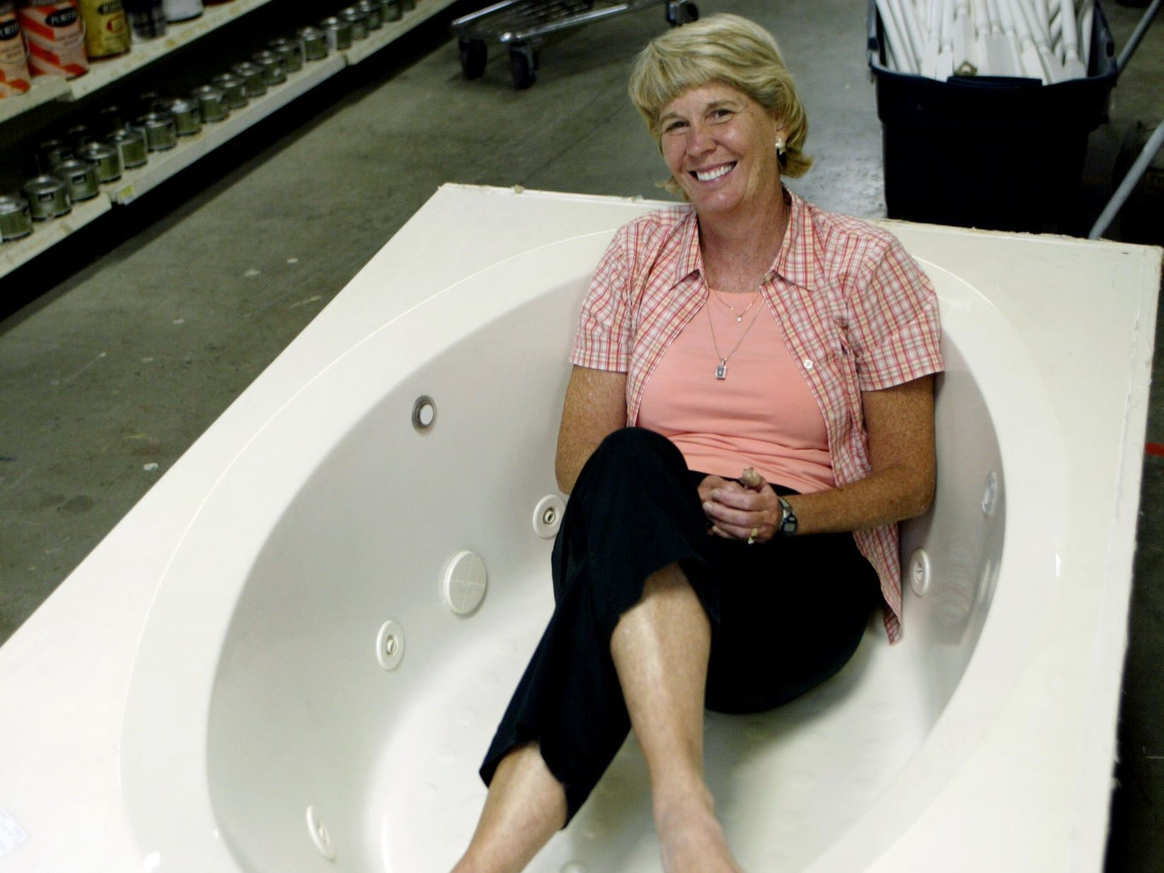 Mary Hance gets comfortable in one of the whirlpool tubs at the Habitat for Humanity HomeStore on July 17, 2006, for a story on most frequently asked questions of Ms. Cheap.