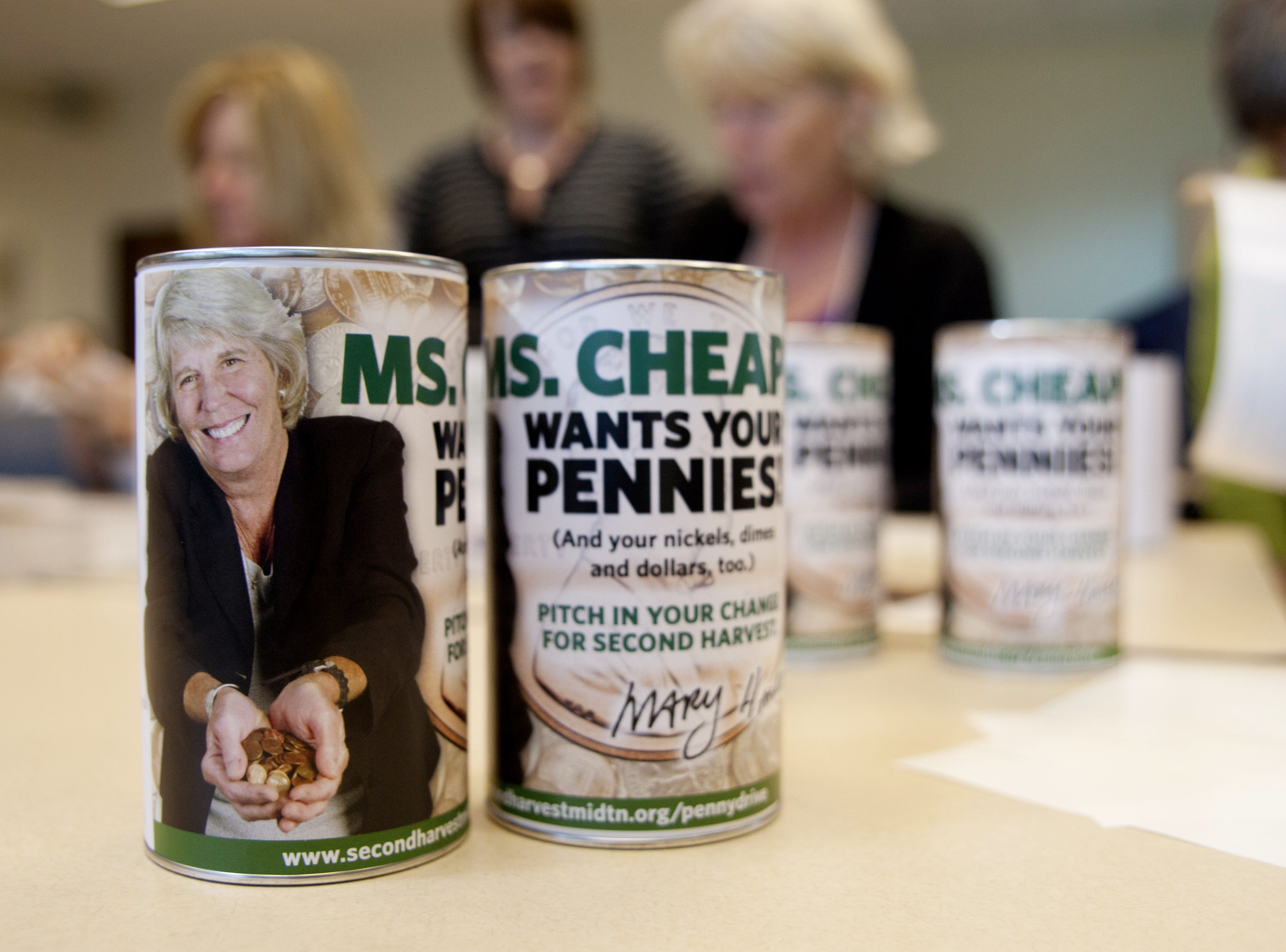 Finished collection cans for Ms. Cheap's annual Penny Drive sit during a work session at Second Harvest in Nashville on Oct. 24, 2012.