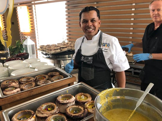 Asif Syed, chef/owner of 21 Spices in East Naples, prepares a coconut curry seafood dish for the NaplesNEXT gala dinner Monday, March 18, 2019, at the Naples Grande Beach Resort.