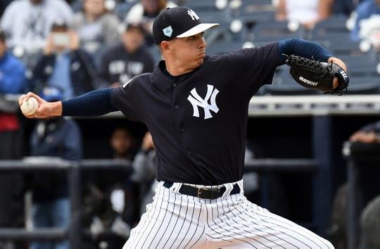 Mar 19, 2019; Tampa, FL, USA; New York Yankees pitcher Chad Green (57) throws a pitch in the first inning of the spring training game against the Tampa Bay Rays at George M. Steinbrenner Field.