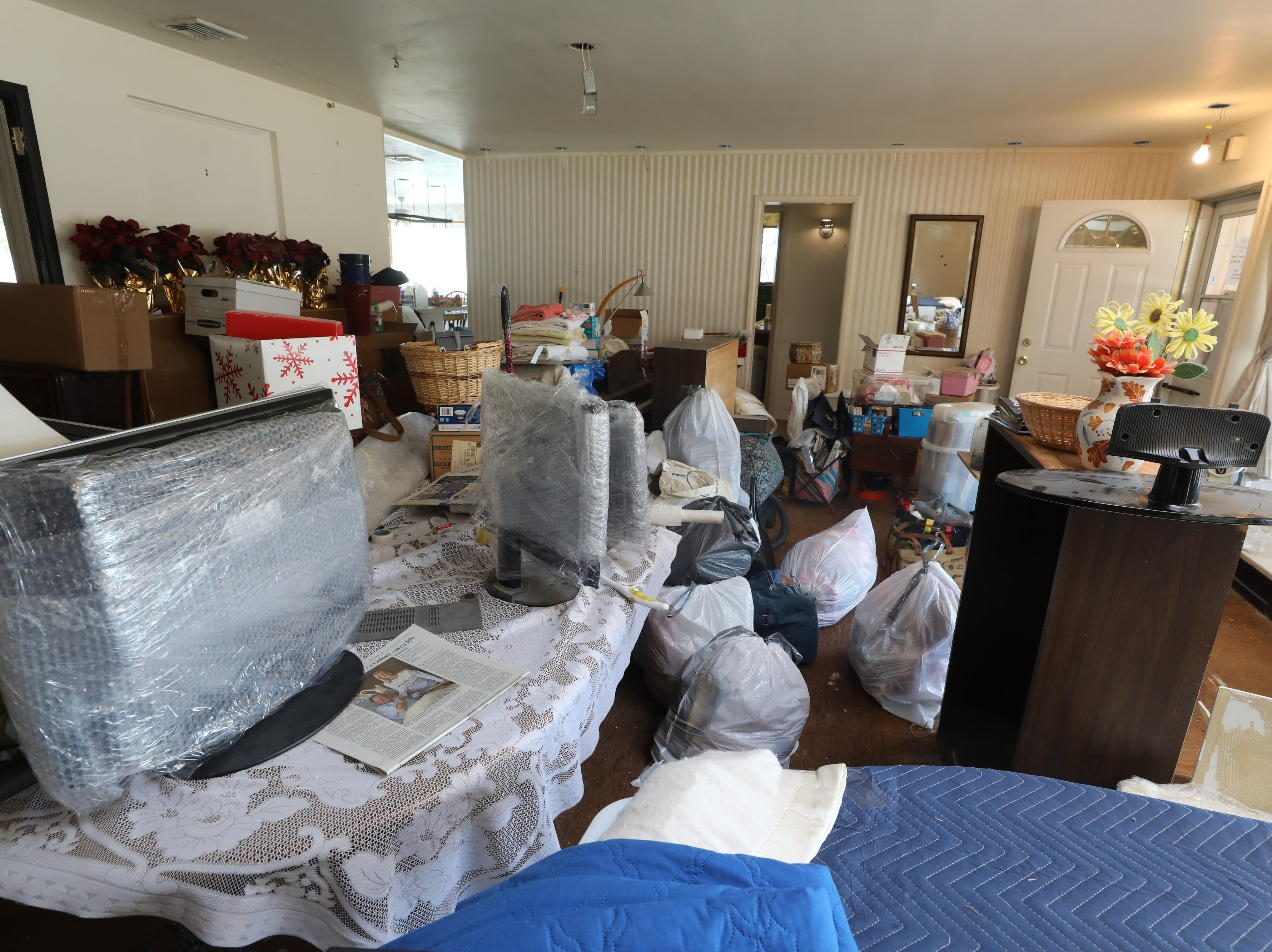 The dining room of the home Charles D'Alessandro and his sister have lived in for the past 15 years. He is being evicted from the home on March 19, 2019, after failing to pay the mortgage for the past 10 years.