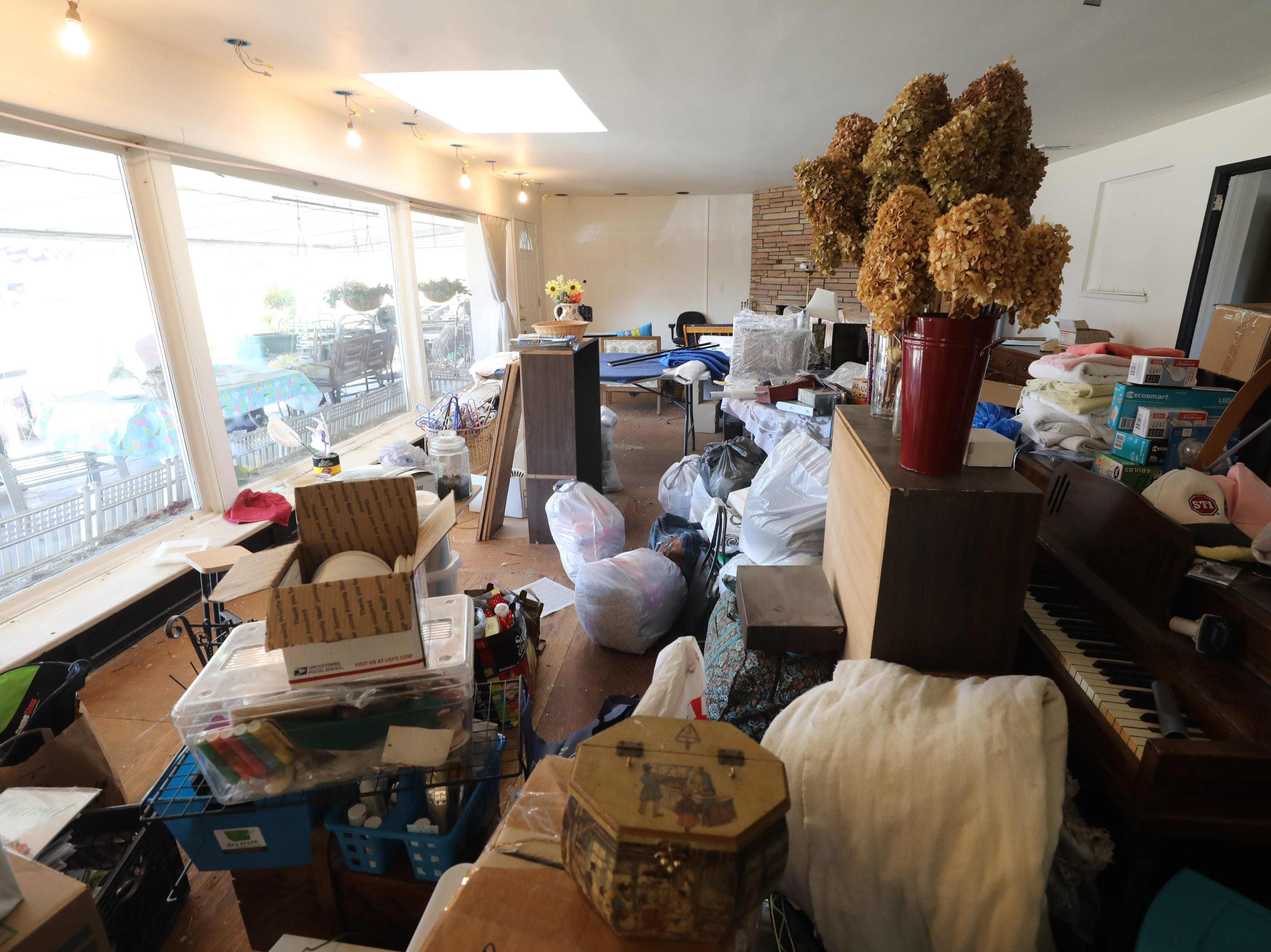 Items are ready to be moved in the living room of the home where Charles D'Alessandro and his sister have lived for the past 15 years. They are being evicted from the home on March 19, 2019, after failing to pay the mortgage for the past 10 years.