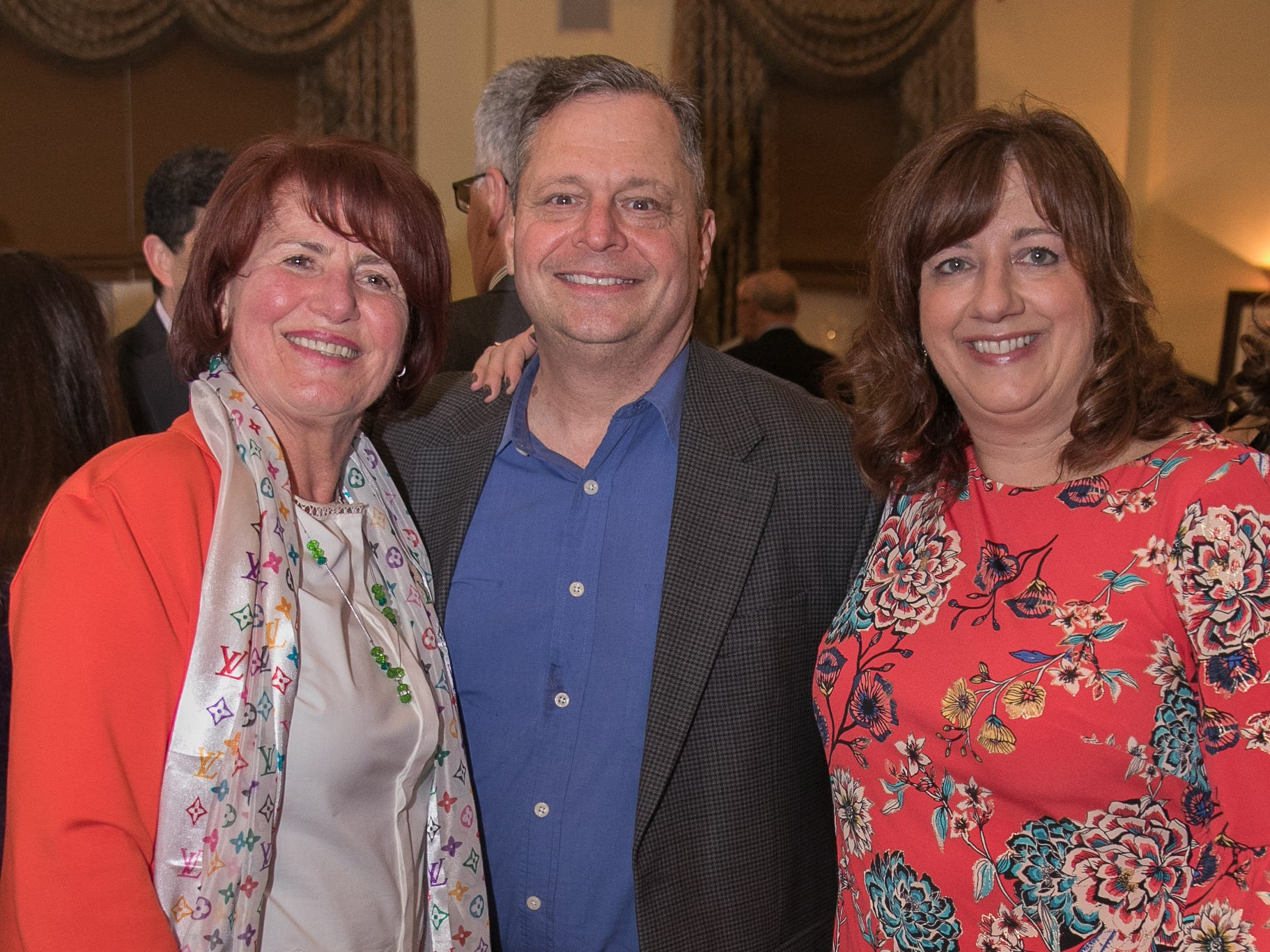 Emmy Eliya,Warren and Maryann Stoll. The Emmanuel Cancer Foundation 9th Annual Bash at The Brick House. 03/15/2019