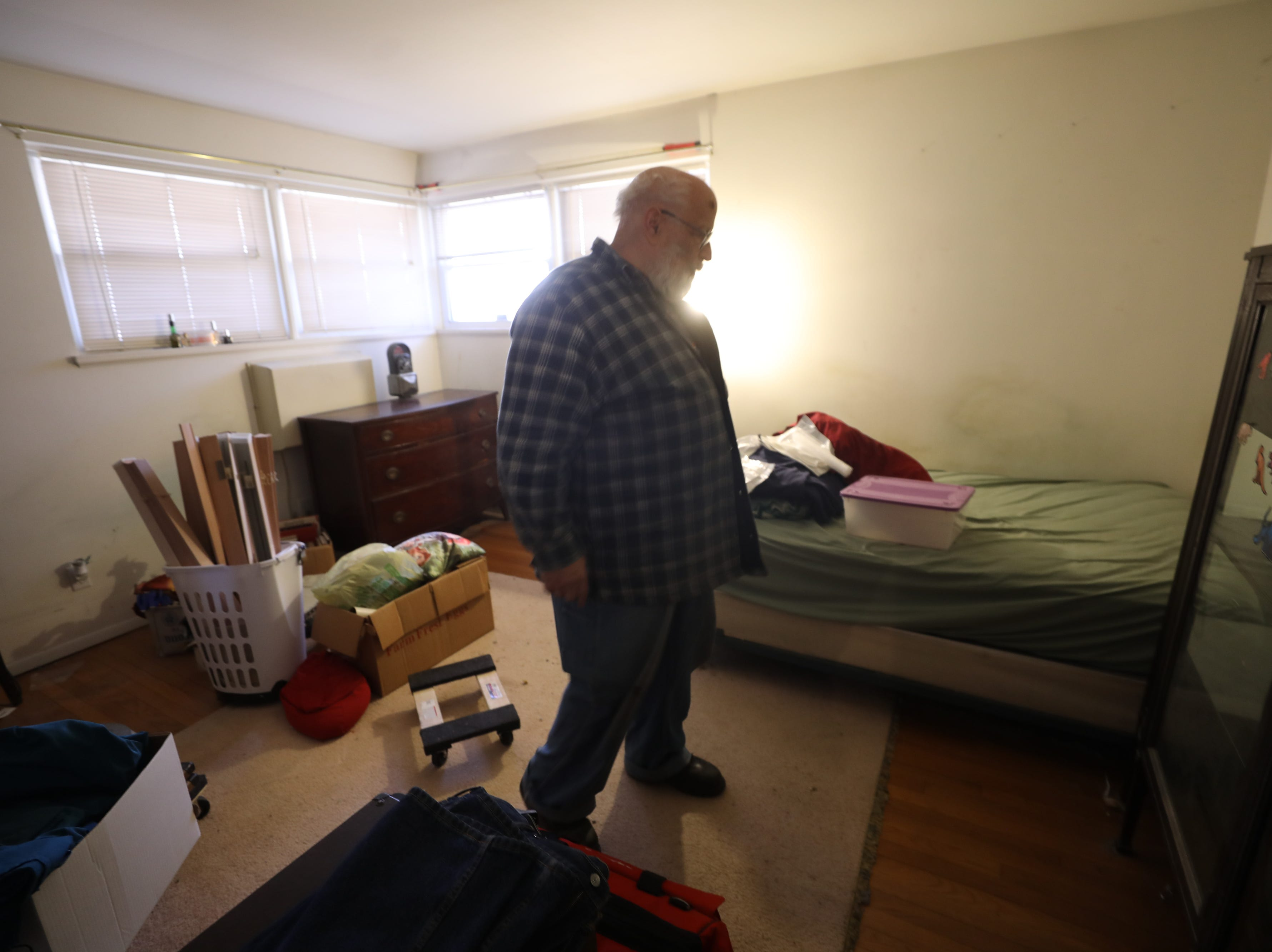 Charles D'Alessandro stands in one of the bedrooms of the home he has lived in for the past 15 years. He is being evicted from the home on March 19, 2019, after failing to pay the mortgage for the past 10 years.
