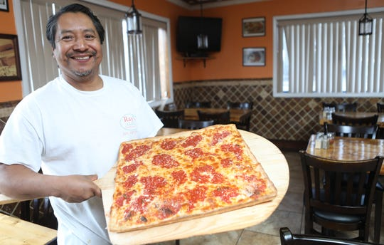 Chef and Owner of Ray's Pizza, Ray Morales, poses with his grandma pie, in Fair Lawn. Tuesday, March 19, 2019
