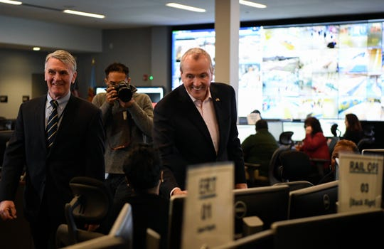 New Jersey Governor Phil Murphy, right, and NJ Transit Executive Director Kevin Corbett, far left, visit employees at the NJ Transit emergency operations center in Maplewood on Tuesday, March 19, 2019.