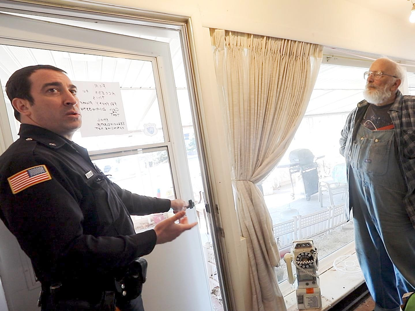 Passaic County Sheriff's Officer Nick D'Agostini informs Charles D'Alessandro that his eviction has been postponed for another week. He is being evicted from the home on March 19, 2019, after failing to pay the mortgage for the past 10 years.