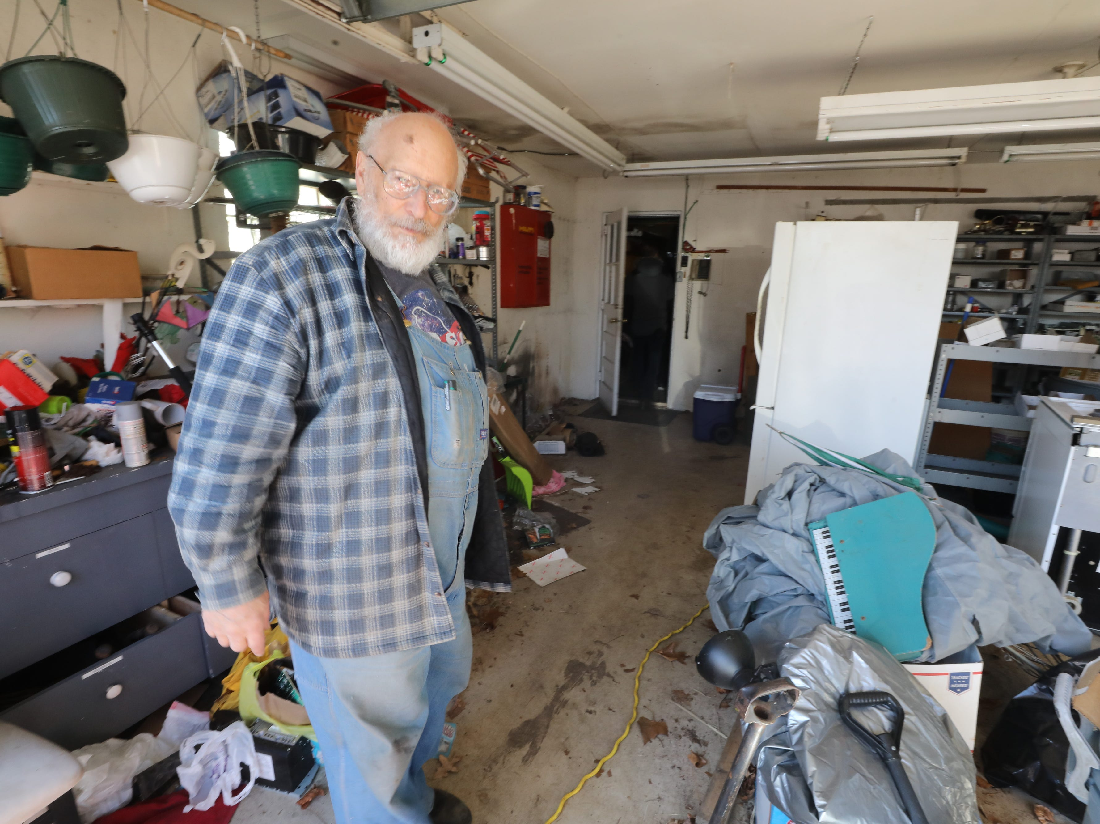 Charles D'Alessandro in the garage of the home he has lived in for the past 15 years. He is being evicted from the home on March 19, 2019, after failing to pay the mortgage for the past 10 years.