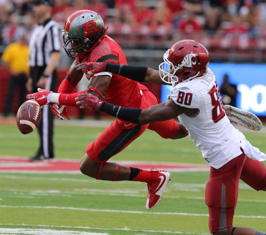 Rutgers cornerback Blessuan Austin breaks up this pass intended for Washington State's Dom Williams in the second half.