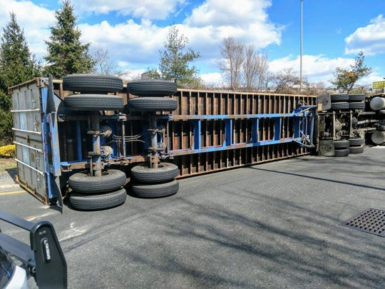 An overturned tractor-trailer closed a Route 80 entrance ramp in Hackensack March 19, 2019.