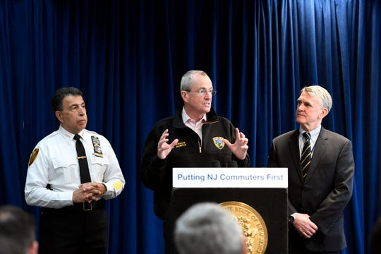(from left) NJ Transit Police Chief Christopher Trucillo, Governor Phil Murphy, and NJ Transit Executive Director Kevin Corbett hold a press conference at the NJ Transit emergency operations center in Maplewood on Tuesday, March 19, 2019.