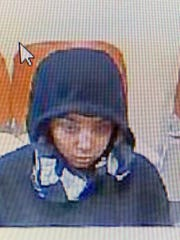 Investigators are asking for the public's help in tracking down a woman who robbed a Chamberlain Avenue bank on Monday