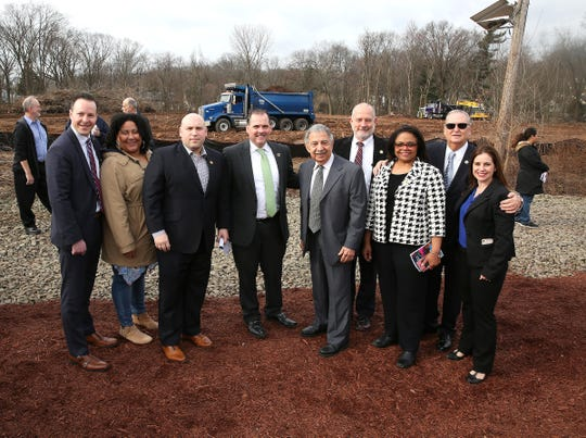 Essex County Freeholder Carlos Pomares, center, and State Assembly Ralph Caputo, second from right, join Bloomfield's Mayor and Council at the Lion Gate Municipal Complex's groundbreaking.
