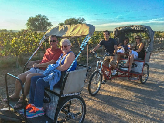 Pedicabs operated by Mesilla Pedicab Co. carry passengers at a festival at La Viña Winery in La Union.